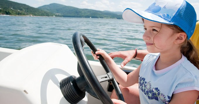 child on boat